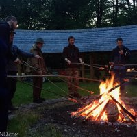 Traditional Polish Campfire Dinner In Białowieża - Smoking Sausages Over Fire