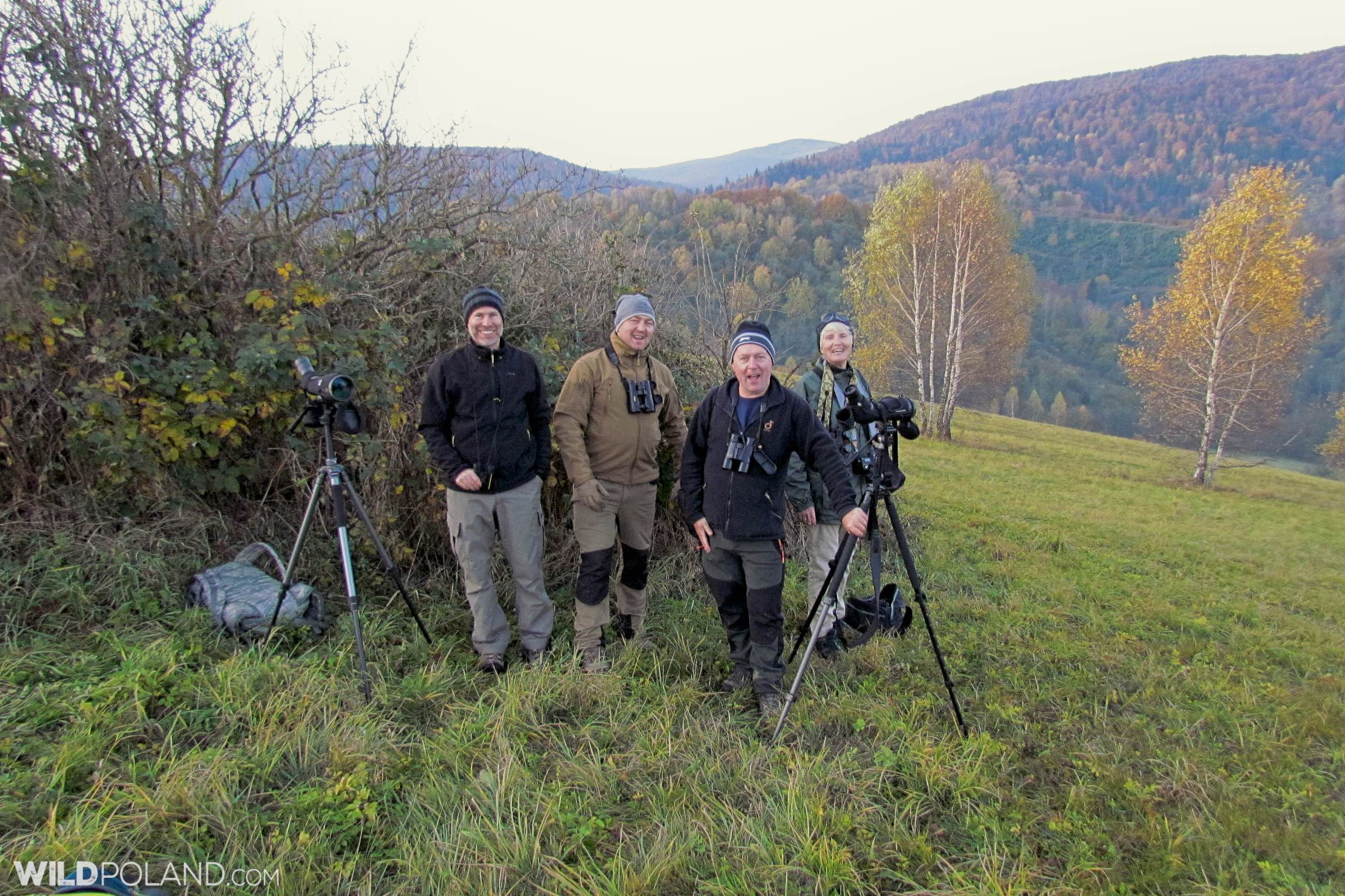 Our happy group from Switzerland, Australia and UK - a moment after watching a pack of 14 Wolves!